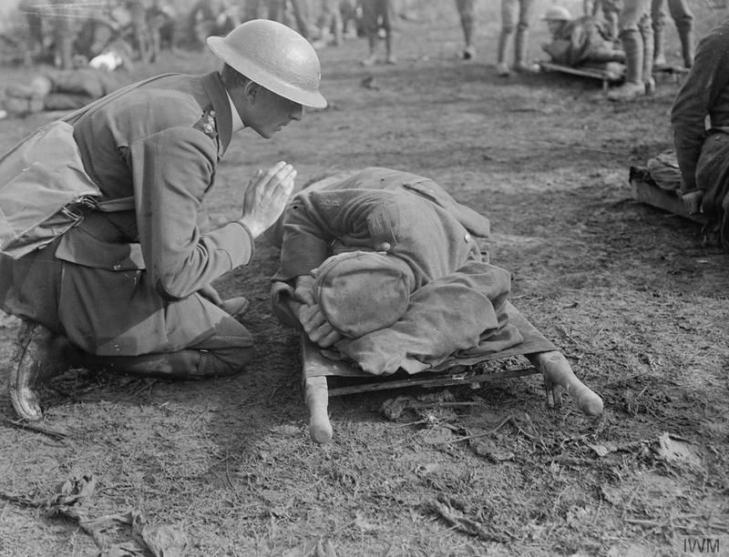 a-british-priest-saying-a-prayer-over-a-german-soldier-during-world-war-i,2252684